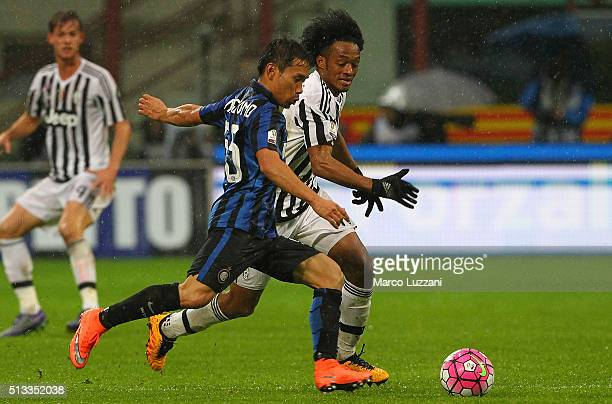 Yuto Nagatomo of FC Internazionale Milano is challenged by Juan Cuadrado of Juventus FC during the TIM Cup match between FC Internazionale Milano and...