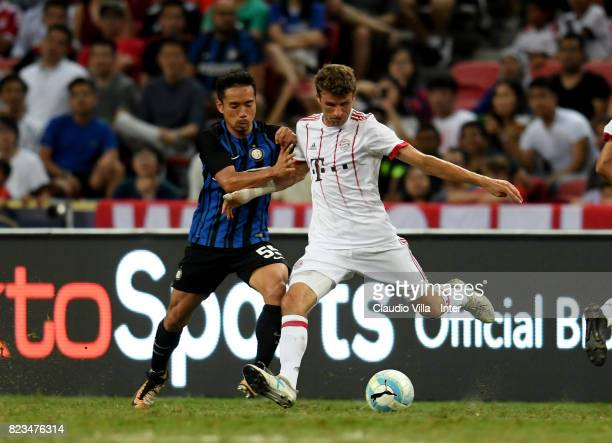Yuto Nagatomo of FC Internazionale of FC Internazionale and Thomas Muller of Bayern compete for the ball during the International Champions Cup match...