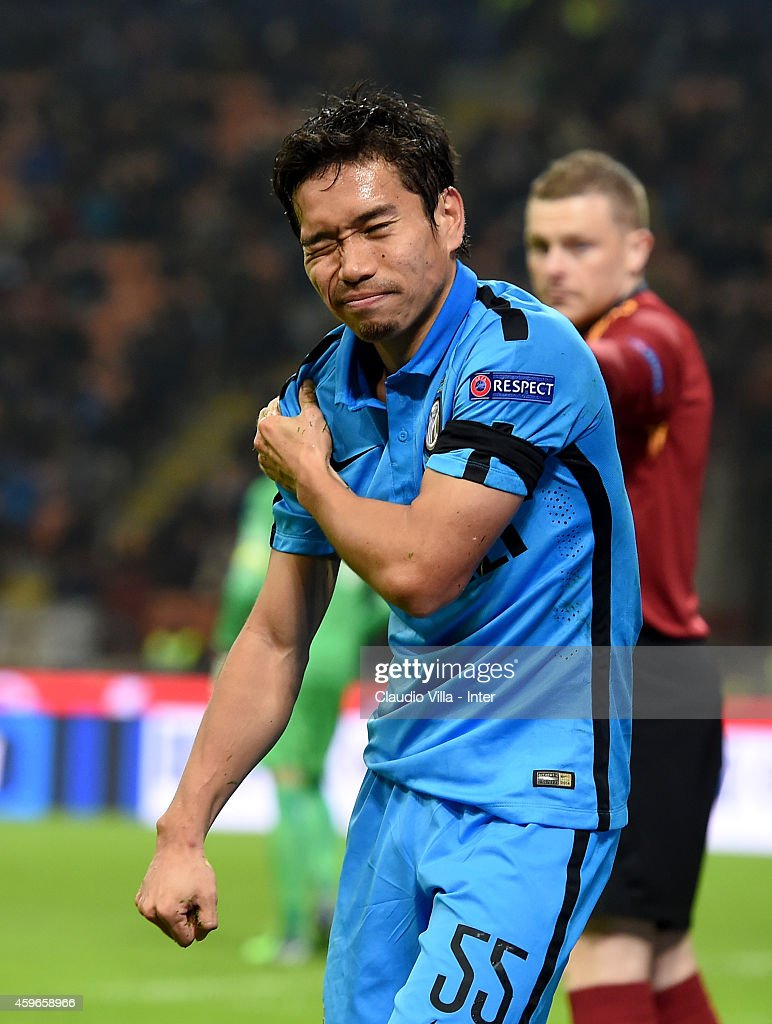 <a gi-track='captionPersonalityLinkClicked' href=/galleries/search?phrase=Yuto+Nagatomo&family=editorial&specificpeople=4320811 ng-click='$event.stopPropagation()'>Yuto Nagatomo</a> of FC Internazionale reacts to being injured during the UEFA Europa League Group F match between FC Internazionale Milano and FC Dnipro Dnipropetrovsk on November 27, 2014 in Milan, Italy.