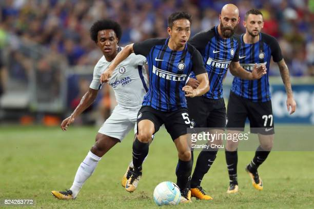 Yuto Nagatomo of FC Internazionale runs away from Willian of Chelsea FC during the International Champions Cup match between FC Internazionale and...