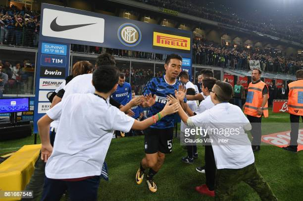 Yuto Nagatomo of FC Internazionale walk out onto the pitch before the Serie A match between FC Internazionale and AC Milan at Stadio Giuseppe Meazza...