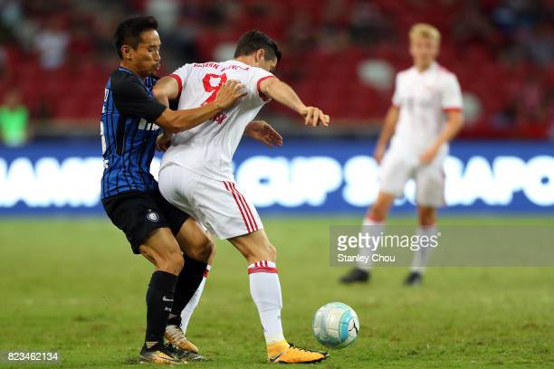Yuto Nagatomo of FC Internzionale trying to tackles Robert Lewandowski of FC Bayern during the International Champions Cup match between FC Bayern...