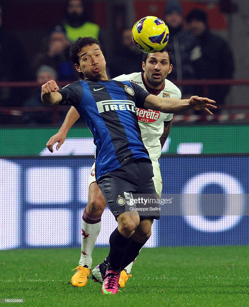 <a gi-track='captionPersonalityLinkClicked' href=/galleries/search?phrase=Yuto+Nagatomo&family=editorial&specificpeople=4320811 ng-click='$event.stopPropagation()'>Yuto Nagatomo</a> of Inter and Mario Santana of Torino in action during the Serie A match between FC Internazionale Milano and Torino FC at San Siro Stadium on January 27, 2013 in Milan, Italy.