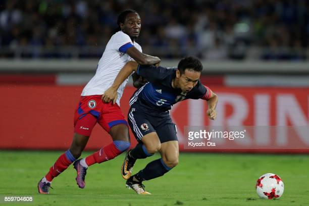 Yuto Nagatomo of Japan and JimmyShammar Sanon of Haiti compete for the ball during the international friendly match between Japan and Haiti at Nissan...