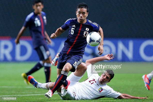 Yuto Nagatomo of Japan controls the ball against Alexander Gonzalez of Venezuela during the international friendly match between Japan and Venezuela...