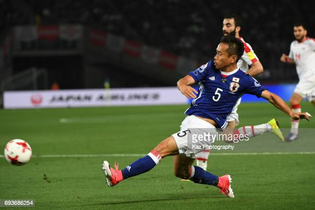 Yuto Nagatomo of Japan crosses the ball during the international friendly match between Japan and Syria at Tokyo Stadium on June 7 2017 in Chofu...