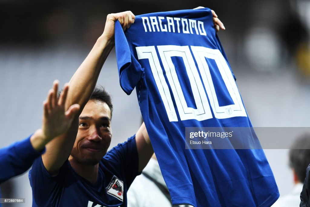 Yuto Nagatomo of Japan poses with a shirt to celebrate his 100th international appearance after during the international friendly match between Brazil and Japan at Stade Pierre-Mauroy on November 10, 2017 in Lille, France.