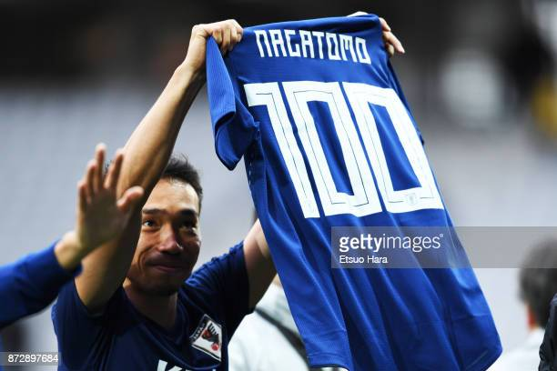 Yuto Nagatomo of Japan poses with a shirt to celebrate his 100th international appearance after during the international friendly match between...