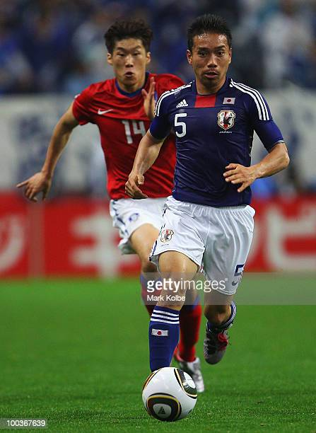 Yuto Nagatomo of Japan runs with the ball during the international friendly match between Japan and South Korea at Saitama Stadium on May 24 2010 in...