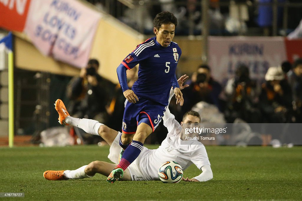 <a gi-track='captionPersonalityLinkClicked' href=/galleries/search?phrase=Yuto+Nagatomo&family=editorial&specificpeople=4320811 ng-click='$event.stopPropagation()'>Yuto Nagatomo</a> #5 of Japan steals the ball from Chris James #13 of New Zealand during the Kirin Challenge Cup international friendly match between Japan and New Zealand at National Stadium on March 5, 2014 in Tokyo, Japan.
