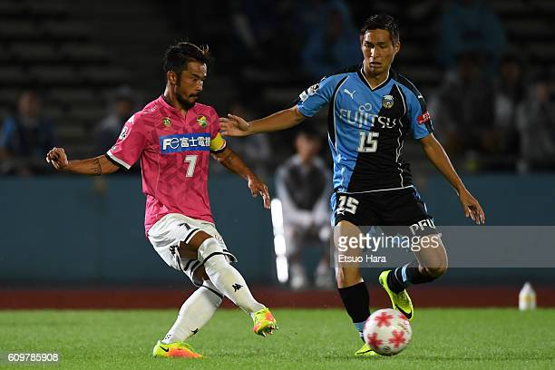 Yuto Sato of JEF United Chiba#7 and Riki Harakawa of Kawasaki Frontale#15 compete for the ball during the Emperor's Cup third round match between...