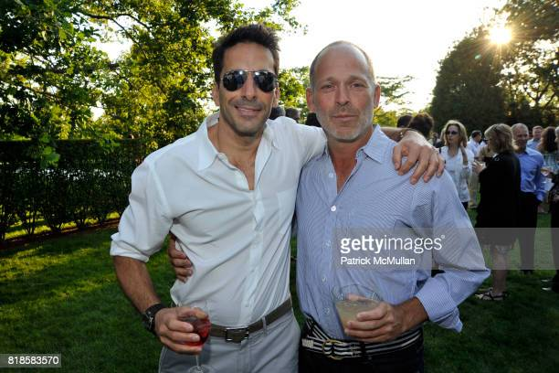 Yuval Hadadi and Herb Sambol attend GODS LOVE WE DELIVERMid Summer Night Drinks Benefit at Home of Chad A Leat on June 19 2010 in Bridgehampton New...