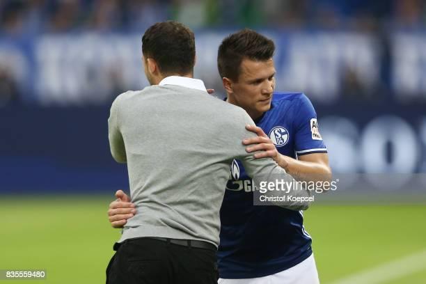 Yuvhen Konoplyanka of Schalke is being substituted by Coach Domenico Tedesco of Schalke during the Bundesliga match between FC Schalke 04 and RB...