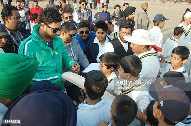 Yuvraj Singh giving autographs to budding players at St Francis School on February 11 2014 in Amritsar India