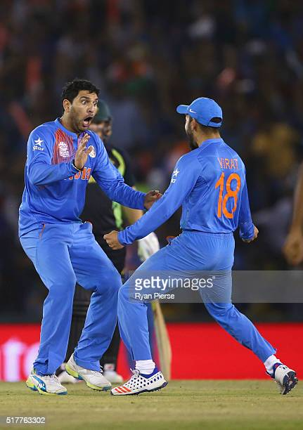 Yuvraj Singh of India celebrates after taking the wicket of Steve Smith of Australia during the ICC WT20 India Group 2 match between India and...