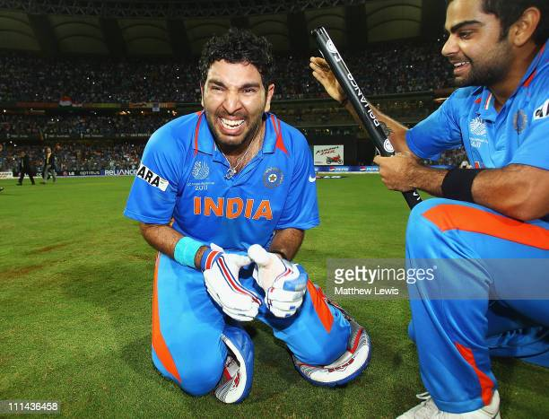 Yuvraj Singh of India celebrates his teams win with Virat Kohli during the 2011 ICC World Cup Final between India and Sri Lanka at the Wankhede...