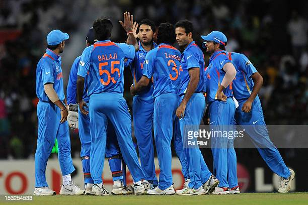 Yuvraj Singh of India celebrates the wicket of AB De Villiers of South Africa with teammates during the ICC World Twenty20 2012 Super Eights Group 2...