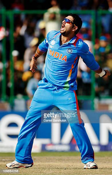 Yuvraj Singh of India celebrates the wicket of Wesley Barresi of the Netherlands during the 2011 ICC Cricket World Cup Group B match between India...