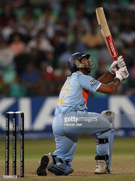 Yuvraj Singh of India hits a six during one over from Stuart Broad of England in which he hit six consecutive sixes to reach his half century in a...