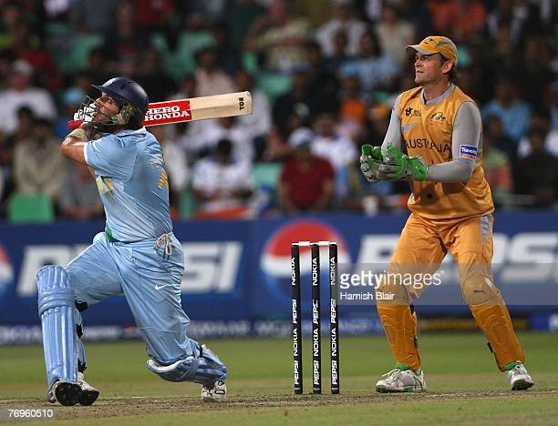 Yuvraj Singh of India hits to mid wicket with Adam Gilchrists of Australia looking on during the ICC Twenty20 Cricket World Championship Semi Final...
