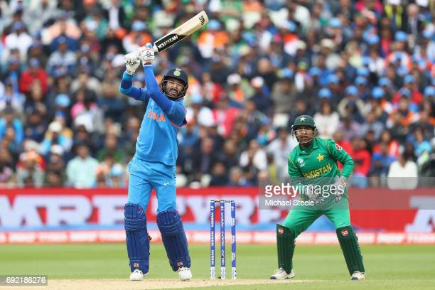 Yuvraj Singh of India hits to the offside as wicketkeeper Sarfraz Ahmed looks on during the ICC Champions Trophy match between India and Pakistan at...