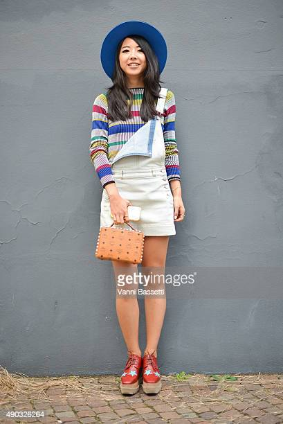 Yuwei Zhangzou poses wearing a Philosophy jumper MCM bag and Stella McCartney shoes during the Milan Fashion Week Spring/Summer 16 on September 27...