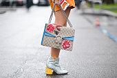Yuwei Zhangzou poses wearing Chiara Ferragni shoes and Gucci bag after the Giorgio Armani show during the Milan Fashion Week Fall/Winter 2016/17 on...