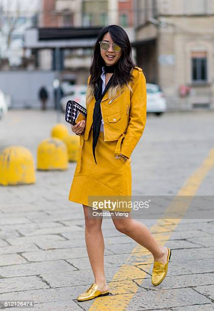 Yuwei Zhangzou wearing a bag from Pierre Hardy sunglasses from Gentle Monster and golden Gucci shoes seen outside Gucci during Milan Fashion Week...