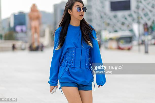 Yuwei Zhangzou wearing a blue sweater and corset attends day 5 of HERA Seoul Fashion Week on October 21 2016 in Seoul South Korea
