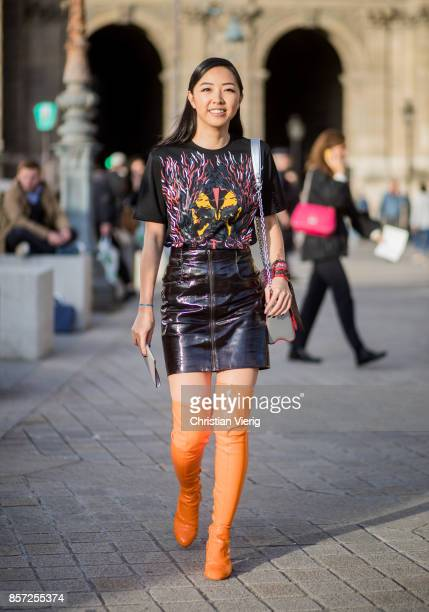 Yuwei Zhangzou wearing orange overknee boots bag seen outside Louis Vuitton during Paris Fashion Week Spring/Summer 2018 on October 3 2017 in Paris...