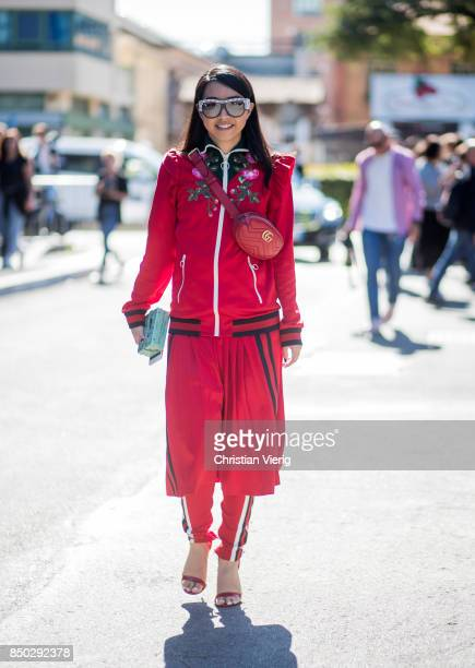 Yuwei Zhangzou wearing red Gucci belt bag is seen outside Gucci during Milan Fashion Week Spring/Summer 2018 on September 20 2017 in Milan Italy