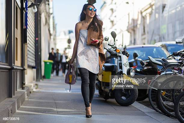 Yuwei Zhangzou wearing Spektre Sunglasses Keepsake dress Acne denim during Paris Fashion Week Womenswear Spring/Summer 2016 on September 30 2015 in...