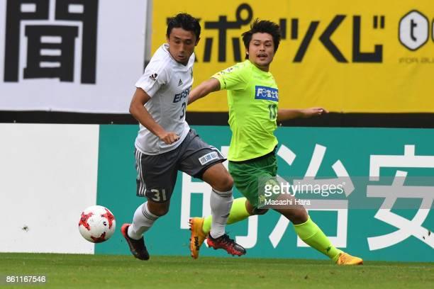 Yuya Hashiuchi of Matsumoto Yamaga and Hirotaka Tameda of JEF United Chiba compete for the ball during the JLeague J2 match between JEF United Chiba...