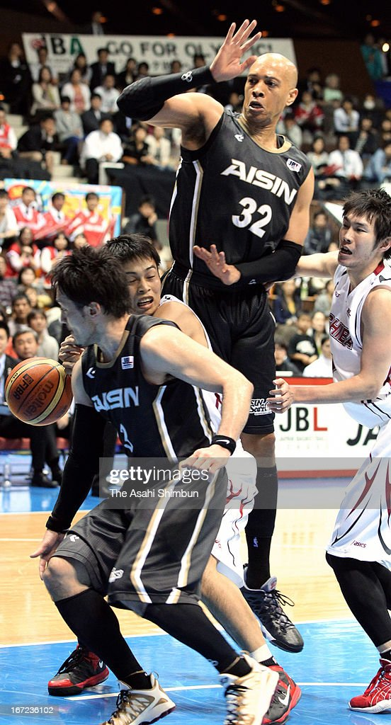 Yuya Kagami of Toshiba Brave Thunders (2L) is blocked by Shinsuke Kashiwagi (1L) and JR Sakuragi (2R) during the Japan Basketball League Playoff Game 5 between Aisin Sea Horses and Toshiba Brave Thunders at Yoyogi Gymnasium on April 22, 2013 in Tokyo, Japan.