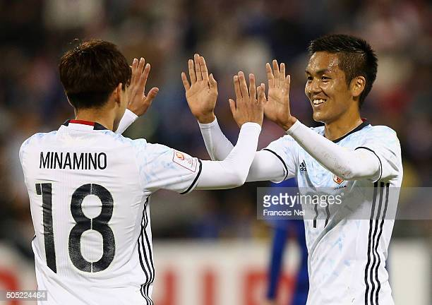 Yuya Kubo and Takumi Minamino of Japan celebrates their fourth goal during the AFC U23 Championship Group B match between Thailand and Japan at Grand...