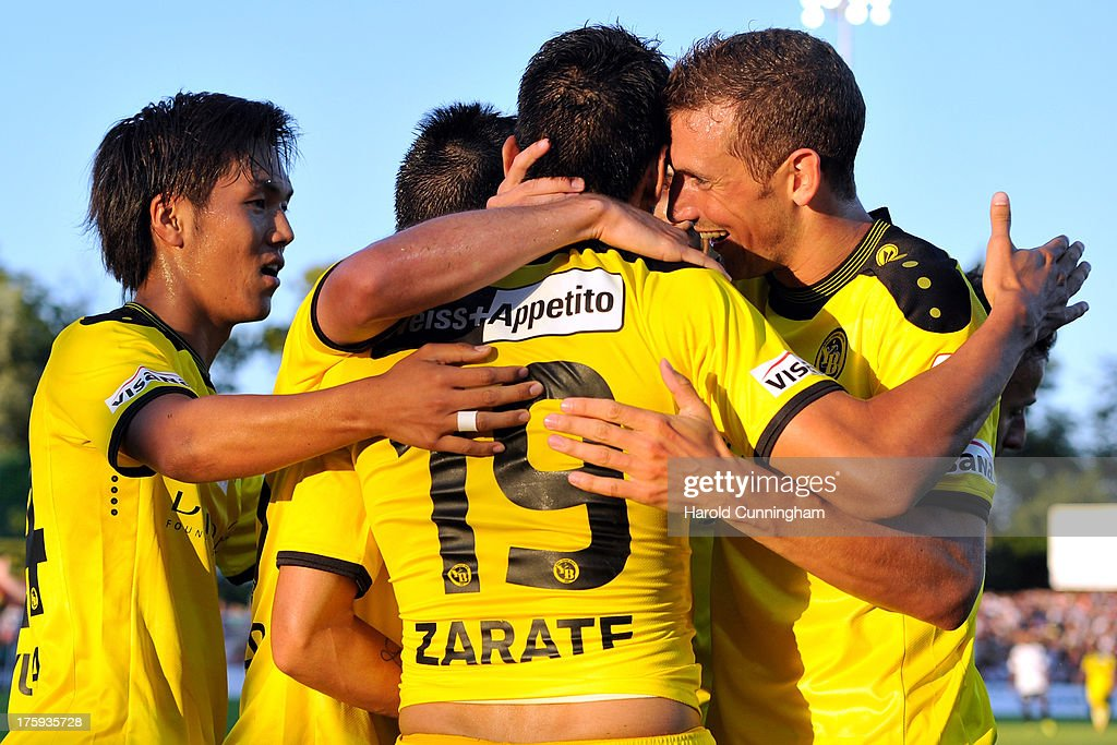 Yuya Kubo (L) celebrates with his team mates the opening goal of Gonzalo Zarate (C) of BSC Young Boys in action during the Swiss Super League match between FC Aarau v BSC Young Boys at Brugglifeld on August 10, 2013 in Aarau, Switzerland.