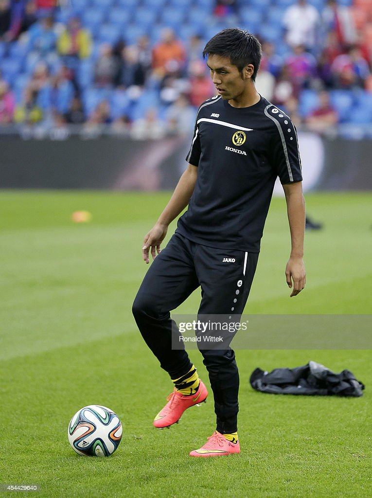 Yuya Kubo of Bern at the warm up with the ball during the Raiffeisen Super League match between FC Basel and BSC Young Boys Bern at St.Jakob-Park on August 31, 2014 in Basel, Switzerland.
