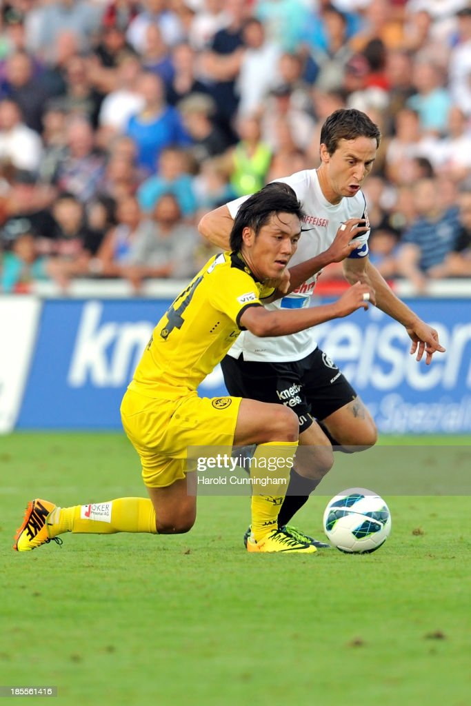 Yuya Kubo of BSC Young Boys and Sandro Burki of FC Aarau in action during the Swiss Super League match between FC Aarau v BSC Young Boys at Brugglifeld on August 10, 2013 in Aarau, Switzerland.