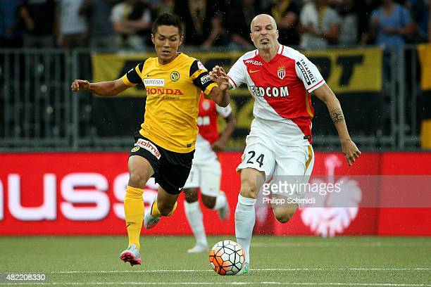 Yuya Kubo of BSC Young Boys competes for the ball with Andrea Raggi of AS Monaco during the UEFA Champions League third qualifying round 1st leg...