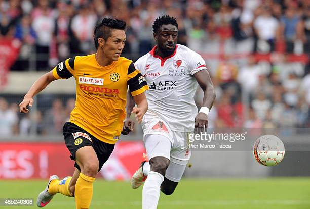 Yuya Kubo of BSC Young Boys competes for the ball with Jagne Pa Modou of FC Sion during the Raiffeisen Super League match between FC Sion and BSC...