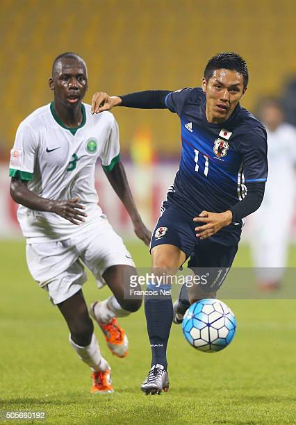 Yuya Kubo of Japan is chased by Abdullah Madu of Saudi Arabia during the AFC U23 Championship Group B match between Saudi Arabia and Japan at Suhaim...