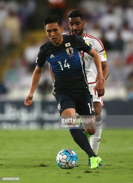 Yuya Kubo of Japan is chased by Khamis Esmaeel of United Arab Emirates during the FIFA 2018 World Cup qualifying match between United Arab Emirates...
