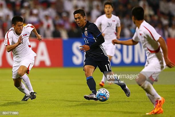 Yuya Kubo of Japan runs at tge North Korea defence during the AFC U23 Championship Group B between Japan and North Korea at Grand Hamad Stadium on...