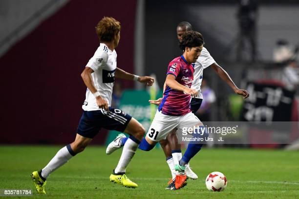 Yuya Nakasaka of Vissel Kobe competes for the ball against Ken Matsubara and Martinus of Yokohama FMarinos during the JLeague match between Vissel...