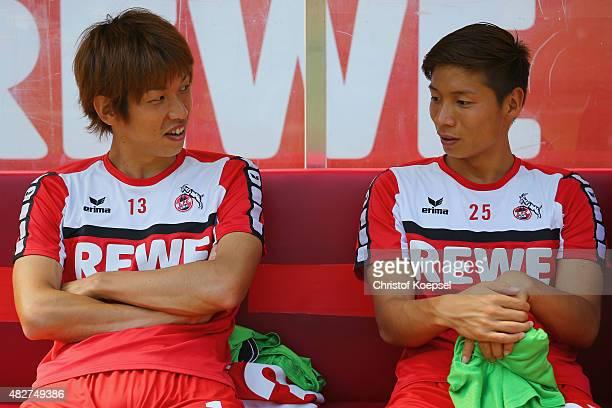 Yuya Osako and Kazuki Nagasawa of Koeln sit on the bench during the Colonia Cup 2015 match between 1 FC Koeln and FC Valencia at RheinEnergieStadion...