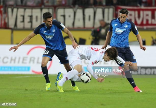 Yuya Osako and Kerem Demirbay and Nadiem Amiri battle for the ball during the Bundesliga match between 1 FC Koeln and TSG 1899 Hoffenheim at...