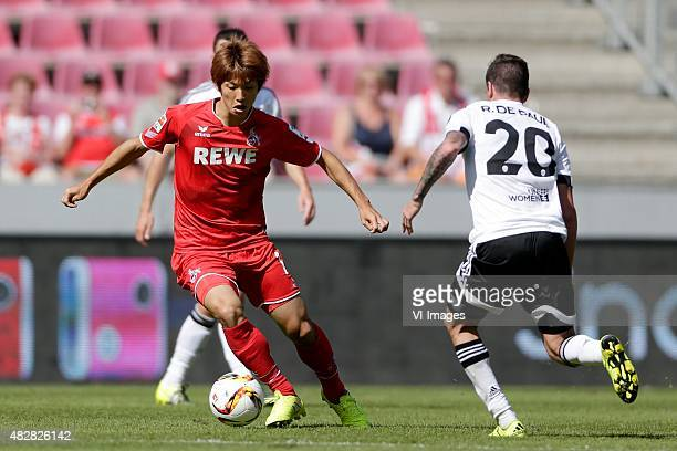 Yuya Osako of 1 FC Koln Rodrigo de Paul of Valencia CF during the Colonia Cup match between 1 FC Koln and Valencia on August 2 2015 at the...