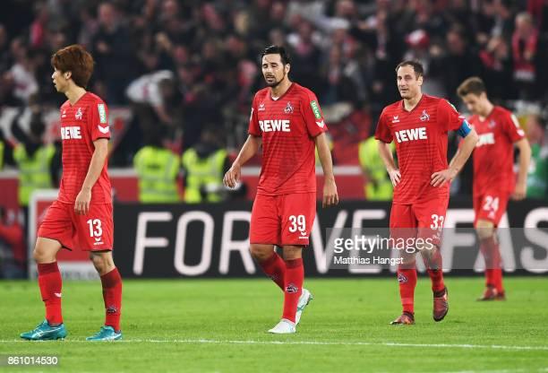Yuya Osako of 1FC Koeln Claudio Pizarro of 1FC Koeln and Mathias Lehmann of 1FC Koeln are dejected after losing the Bundesliga match between VfB...