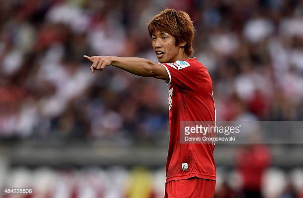 Yuya Osako of 1FC Koeln gestures during the Bundesliga match between VfB Stuttgart and 1 FC Koeln at MercedesBenz Arena on August 16 2015 in...