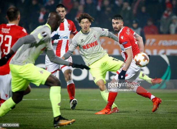 Yuya Osako of FC Koeln in action against Damien Le Tallec of Crvena Zvezda during the UEFA Europa League group H match between Crvena Zvezda and 1 FC...